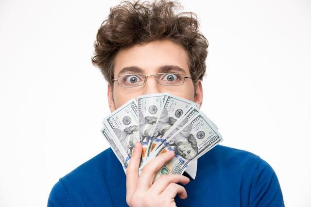 Man holding fan of money