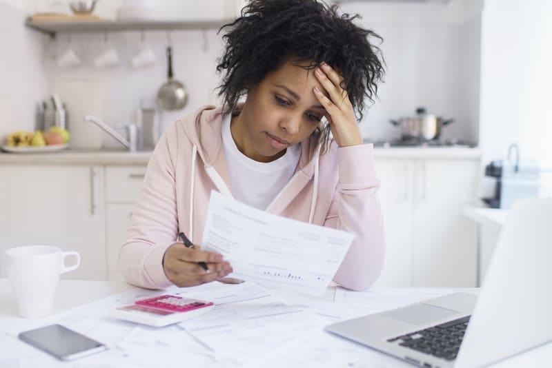 Person looking at bills