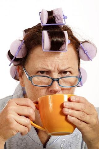 Grumpy lady with curlers and coffee