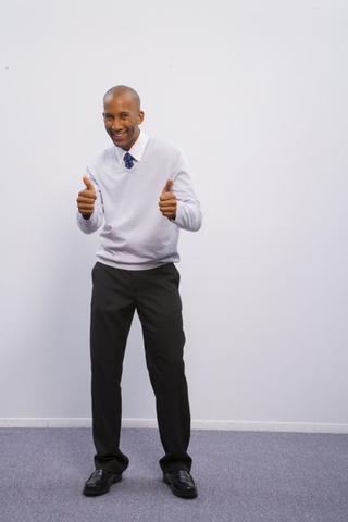 Man holding 2 thumbs up