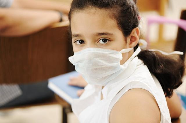 Little girl with health mask